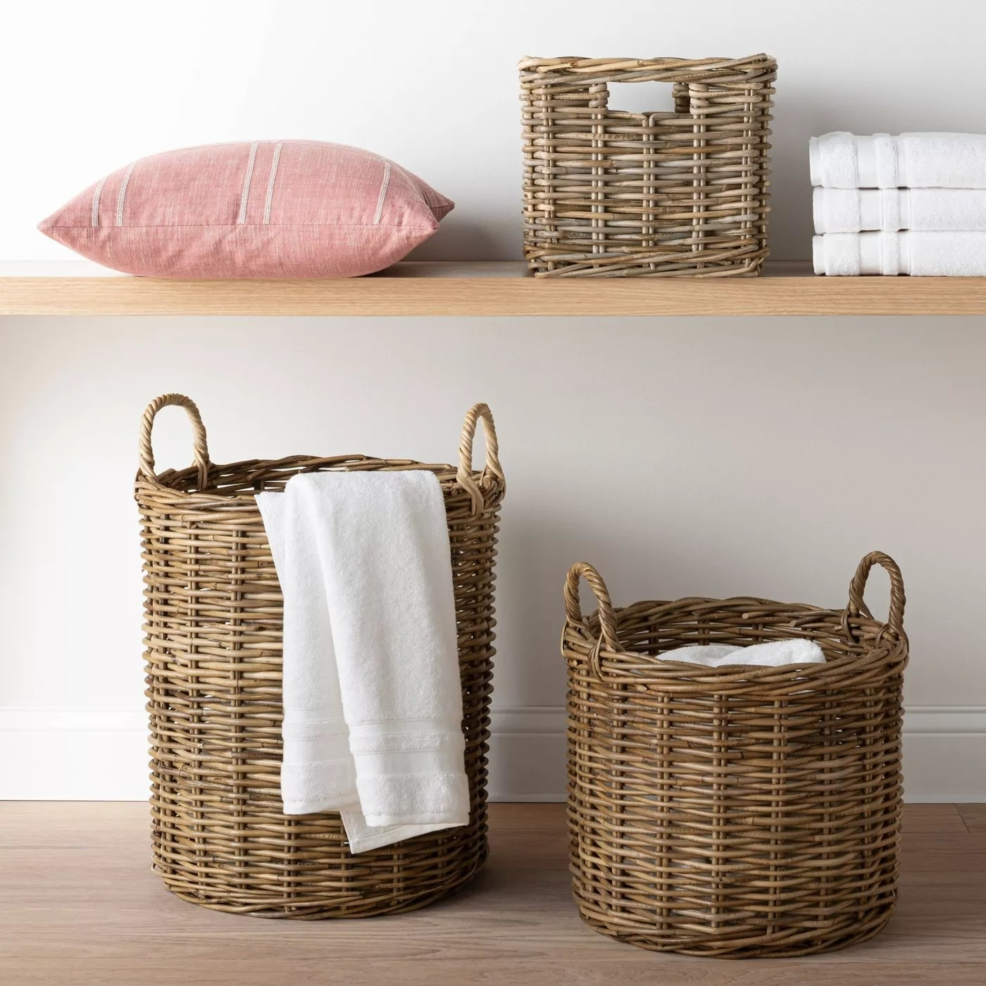 The two woven baskets holding towels