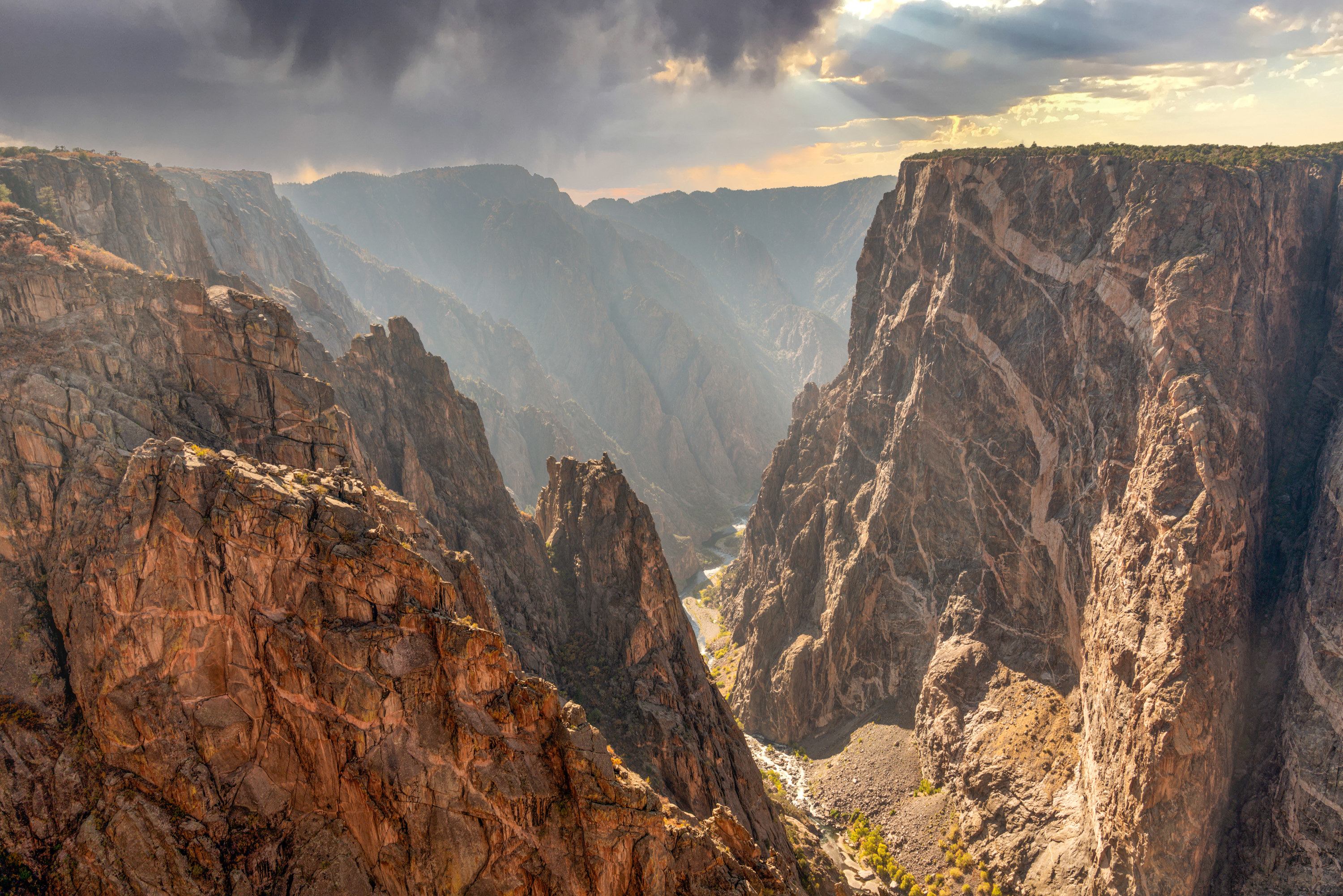 An ominous dark cloud looms over the Black Canyon of Gunnison National Park.