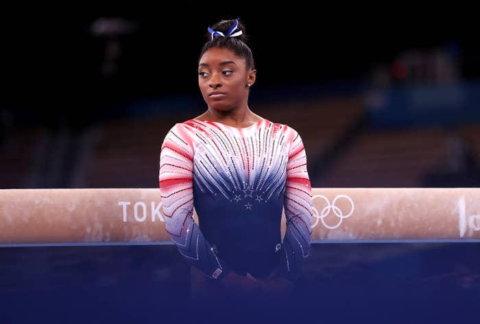 Simone standing in front of the balance beam at the Tokyo Olympics
