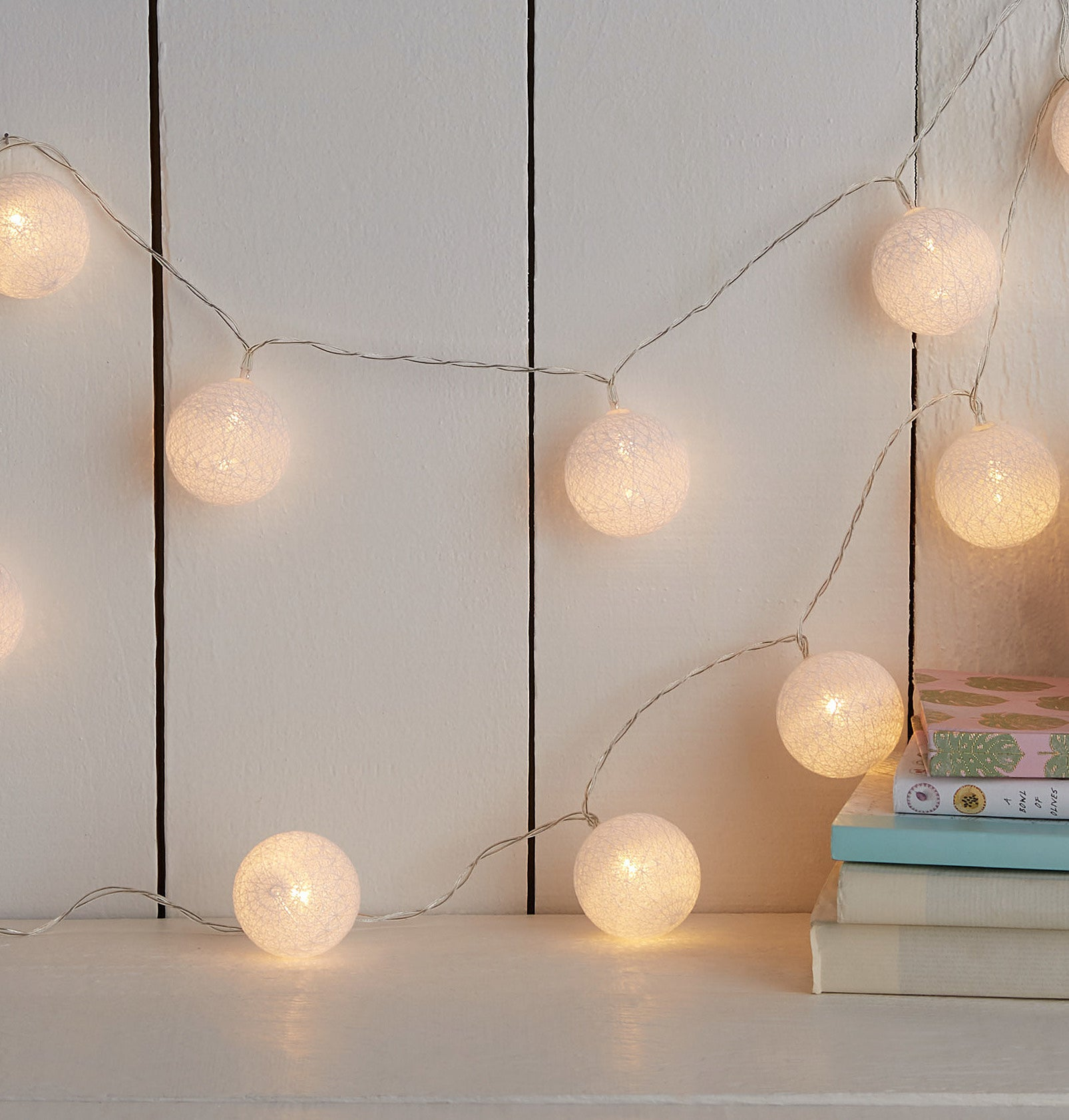 globe lights against a wall