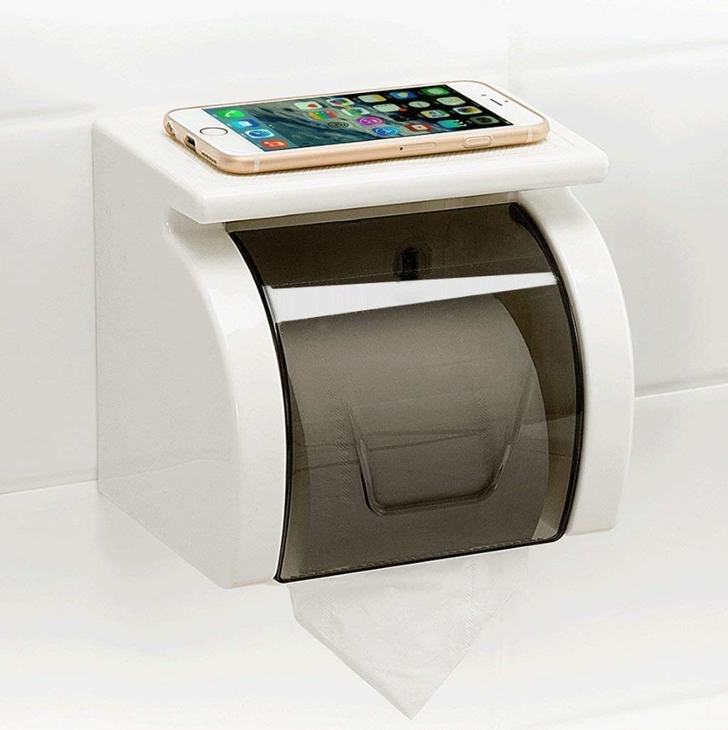 A closed self-adhesive toilet roll holder with a traction top to hold your phone