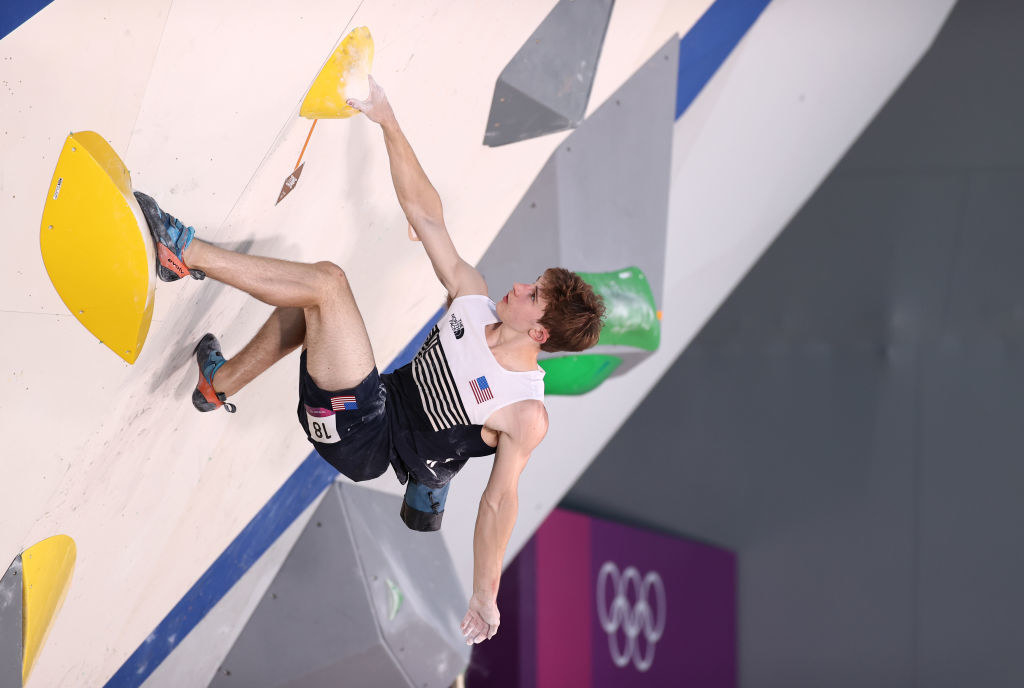 Duffy climbing up a wall during the Sport Climbing Men's Combined, Bouldering Qualification