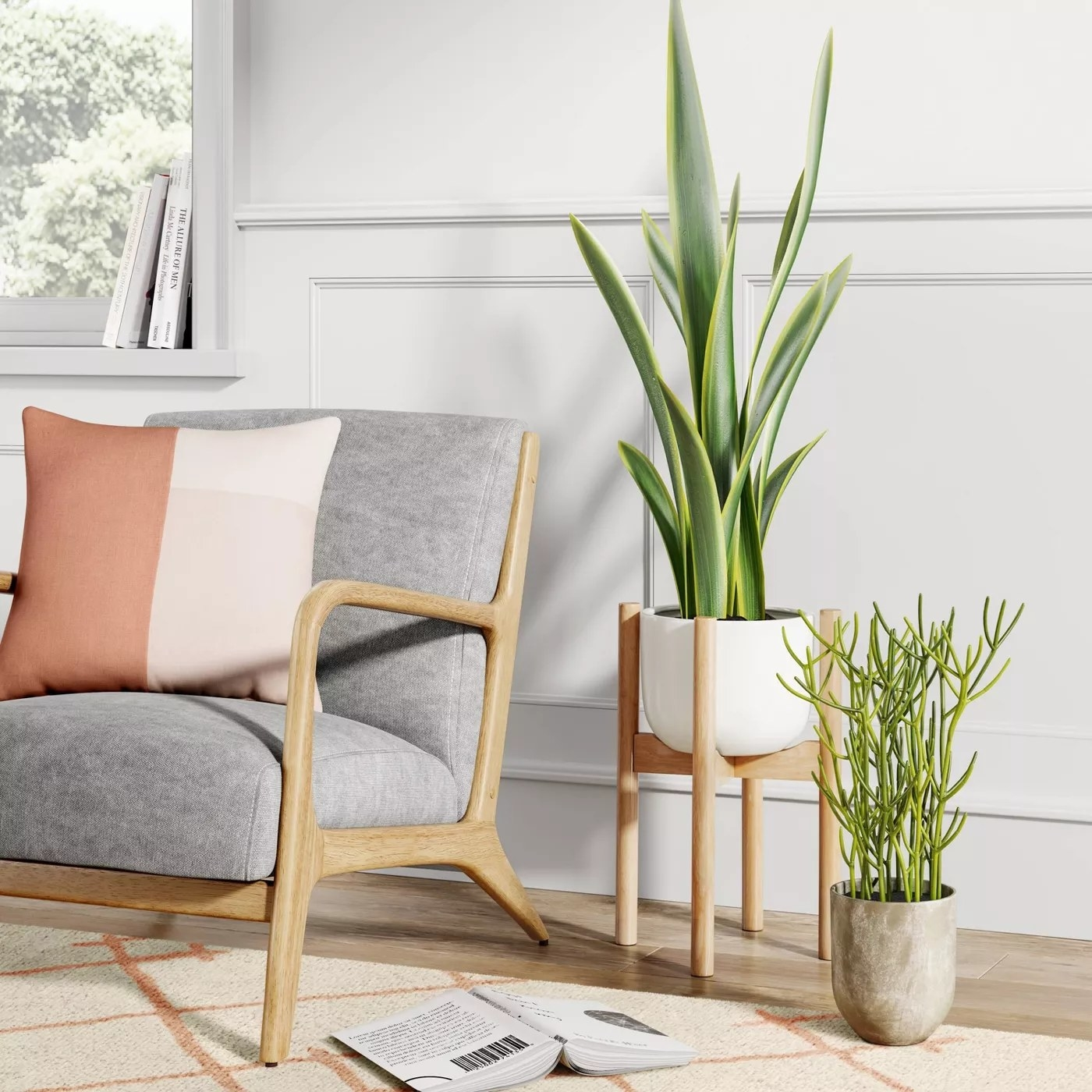 The planters with a wood base and ceramic pot in a living room
