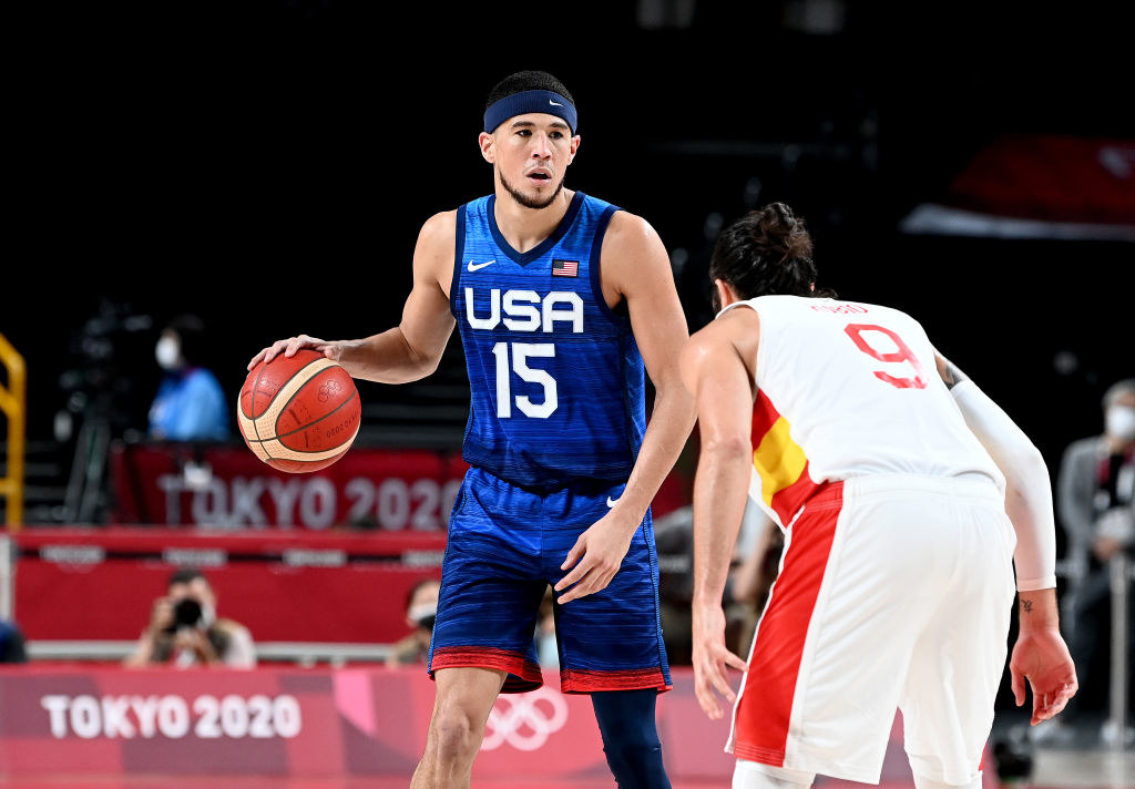 Booker looking to pass during the quarter final Basketball match between the USA and Spain