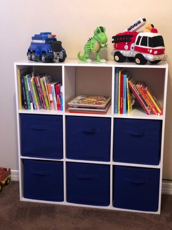 Reviewer's photo showing the blue fabric storage cubes in their shelving unit
