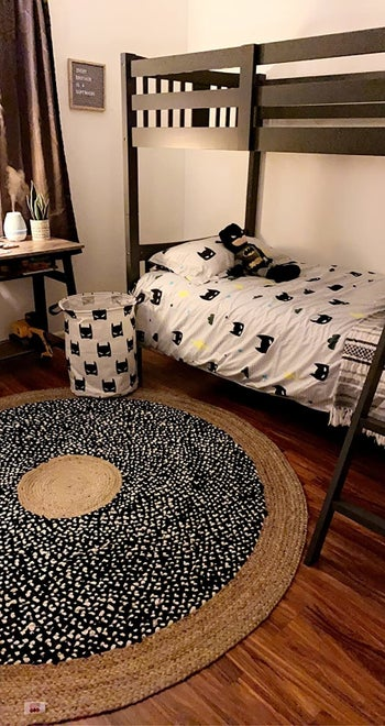 Reviewer's photo showing the canvas bin in bat print in their child's bedroom