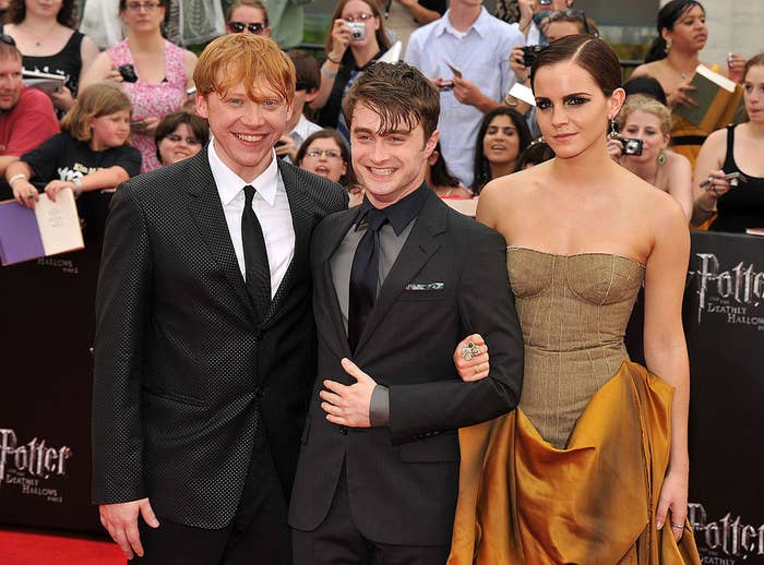 """(L-R) Rupert Grint, Daniel Radcliffe, and Emma Watson attend the New York premiere of """"Harry Potter and the Deathly Hallows: Part 2"""""""