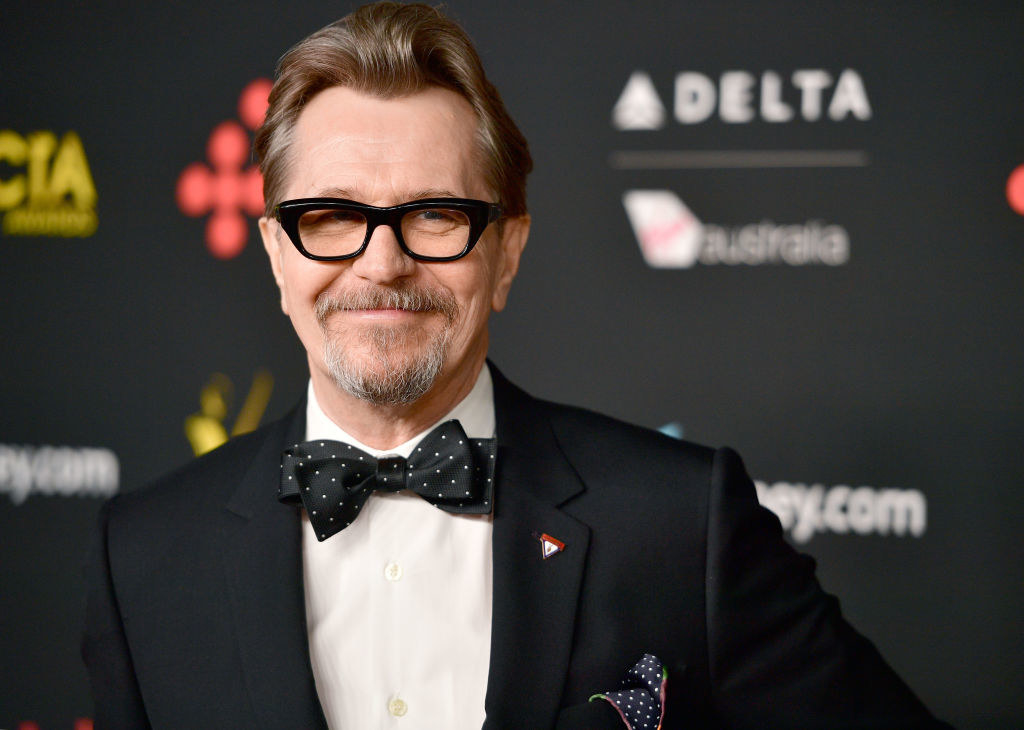 Gary Oldman attends the 7th AACTA International Awards in a suit, polka dot bowtie, and eyeglasses