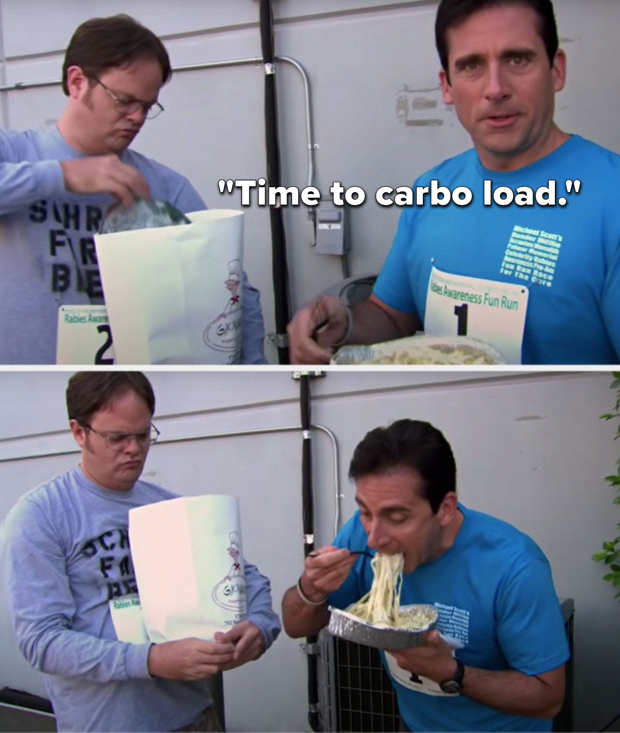 Michael says, Time to carbo load and takes a huge bite of his full fettuccine alfredo meal