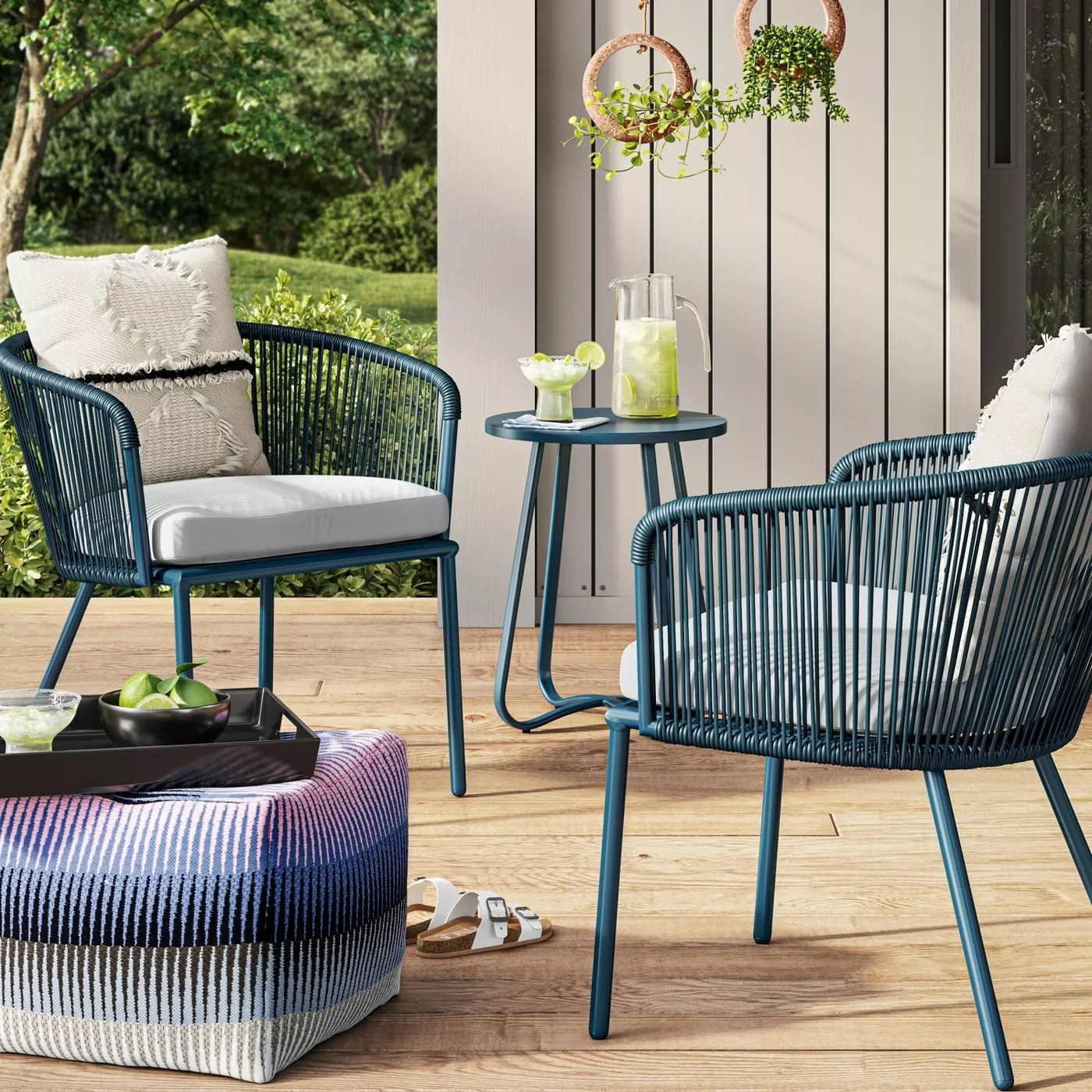A blue patio set with two chairs and a matching table on a deck