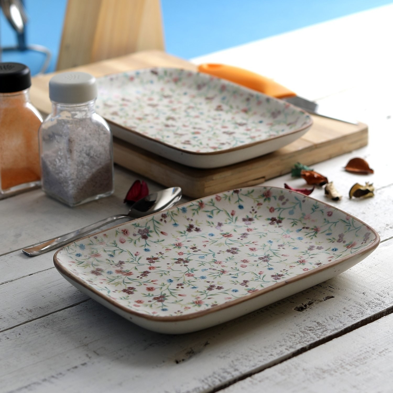 Two rectangular plates with an intricate floral print