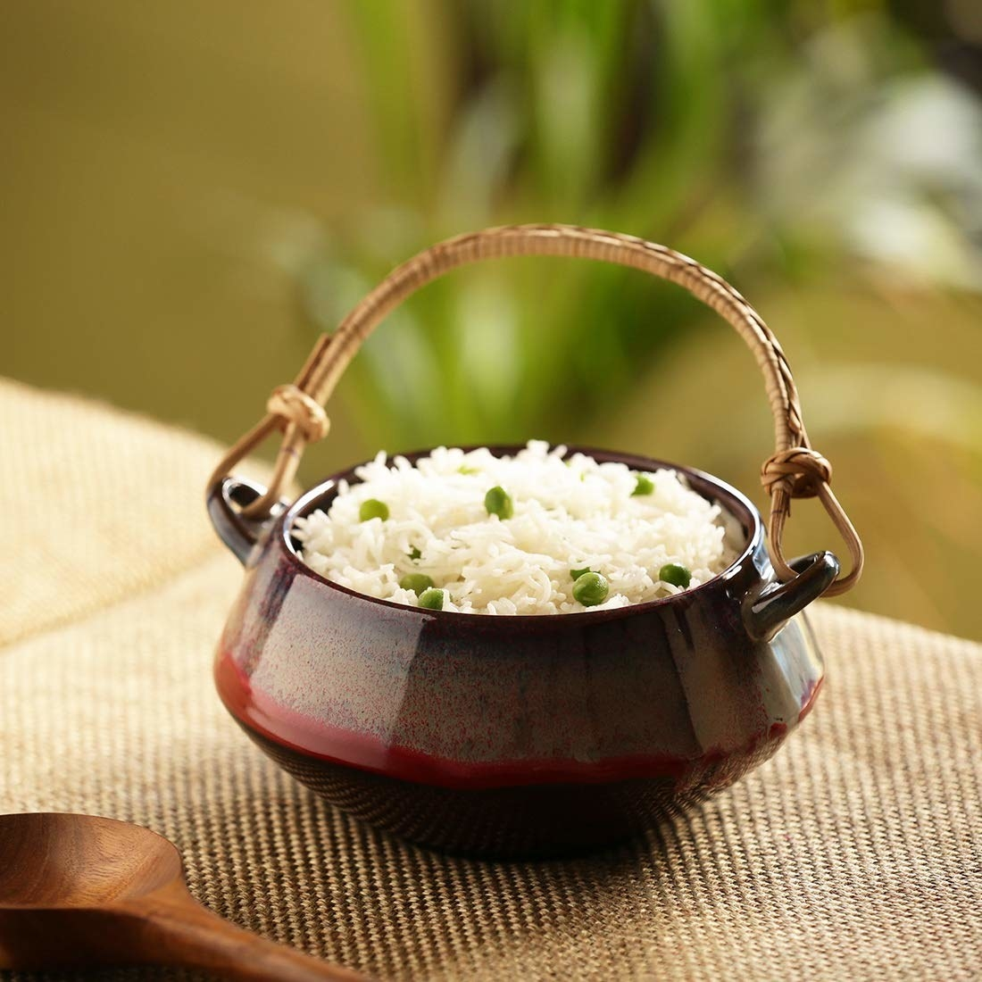 A handi with rice in it