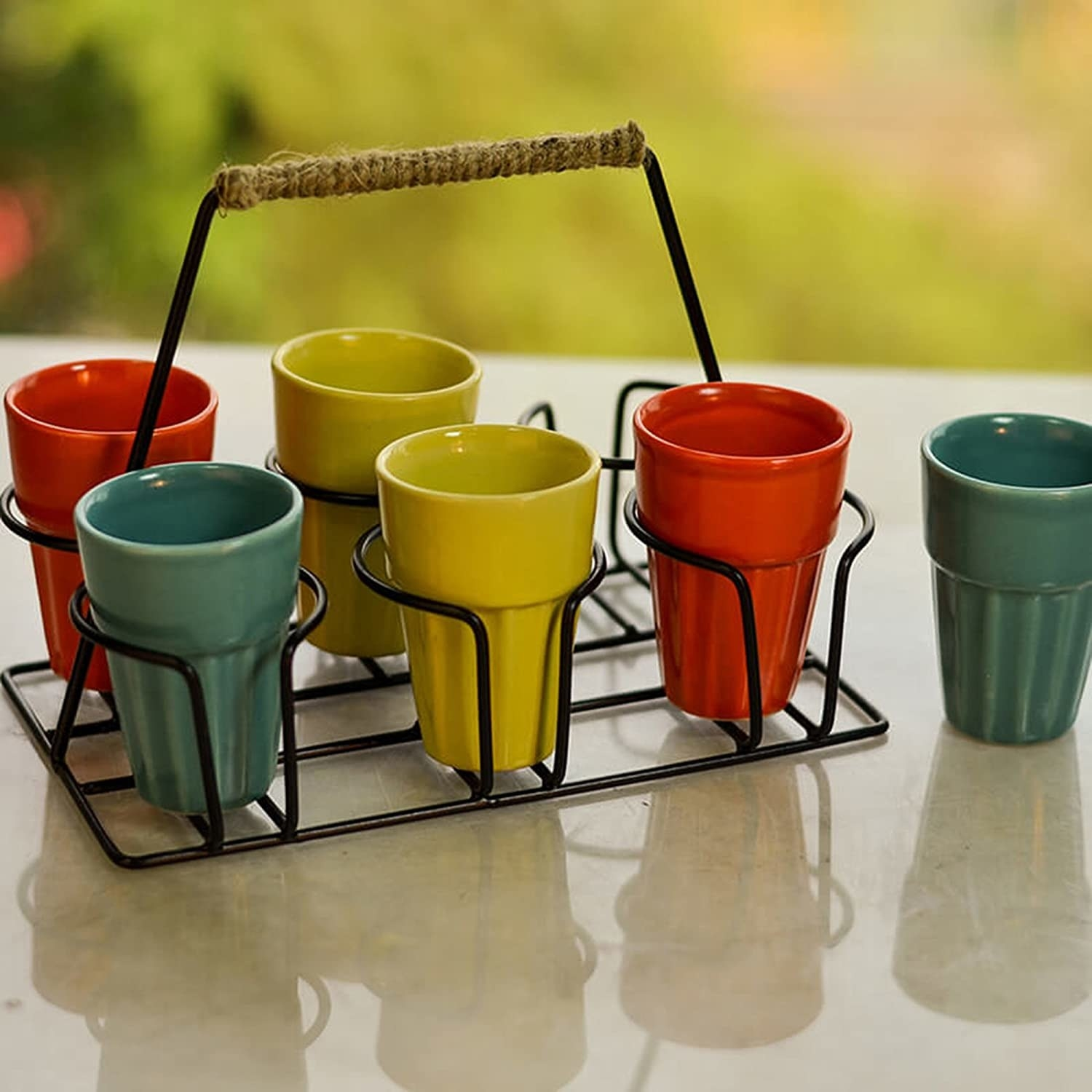 Colourful cutting chai cups placed in a stand