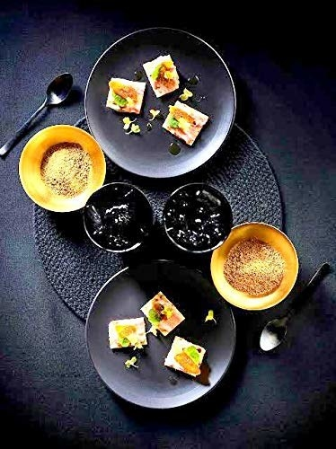 A black plate set with food items on it