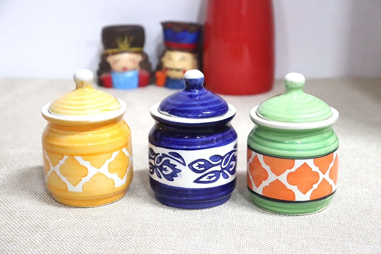 Multicoloured condiment jars on a table