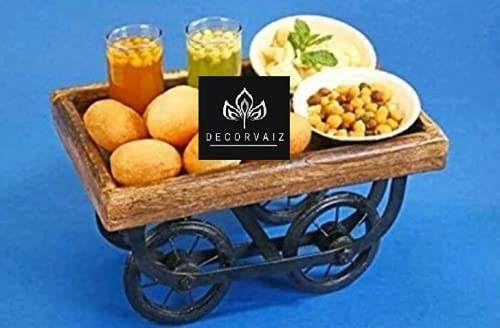 A serving cart with pani puri and accompaniments on it