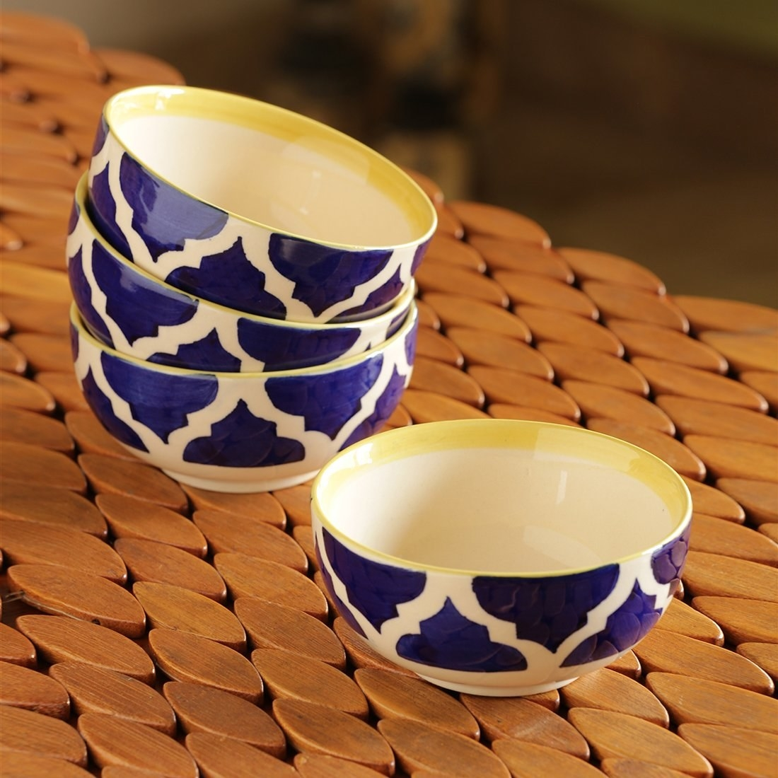 A set of blue and white bowls on a table