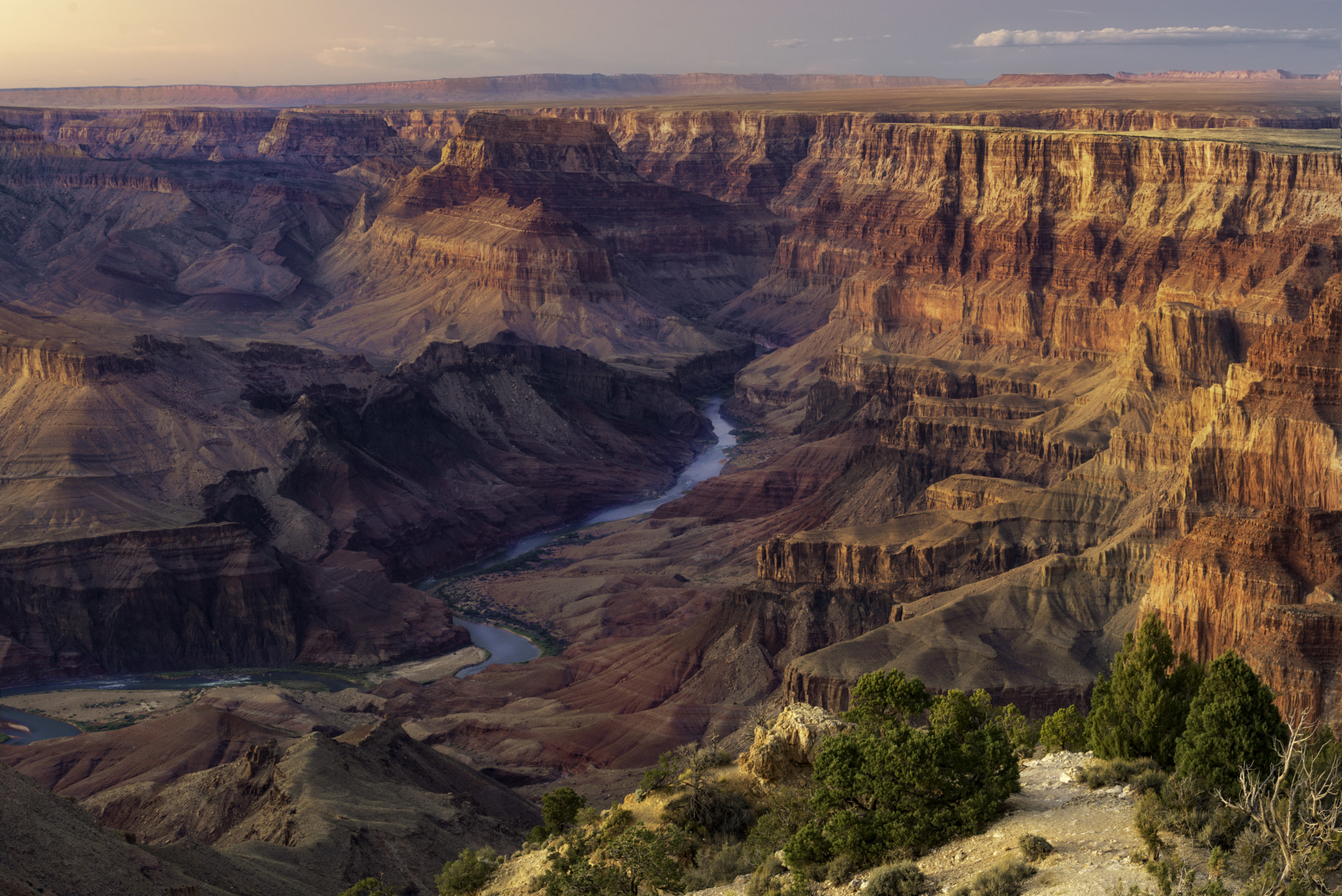 Water coursing through the grand Canyon after sunset.