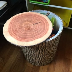 Reviewer using the tree trunk stool as a storage bin with the lid open