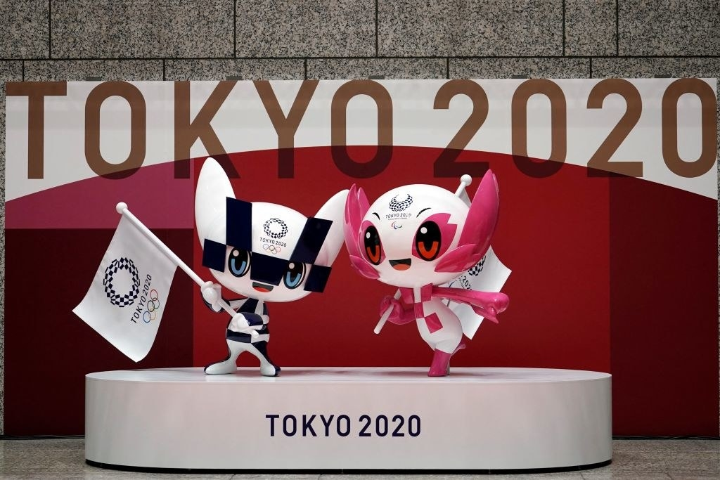 Miraitowa andSomeity figures standing on a podium