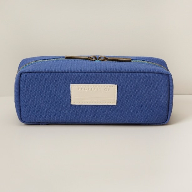 a pencil case with two zippers and a spot to write your name