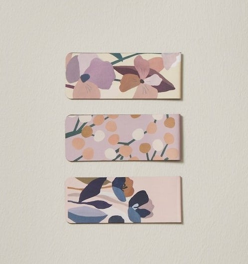 three floral magnetic book marks