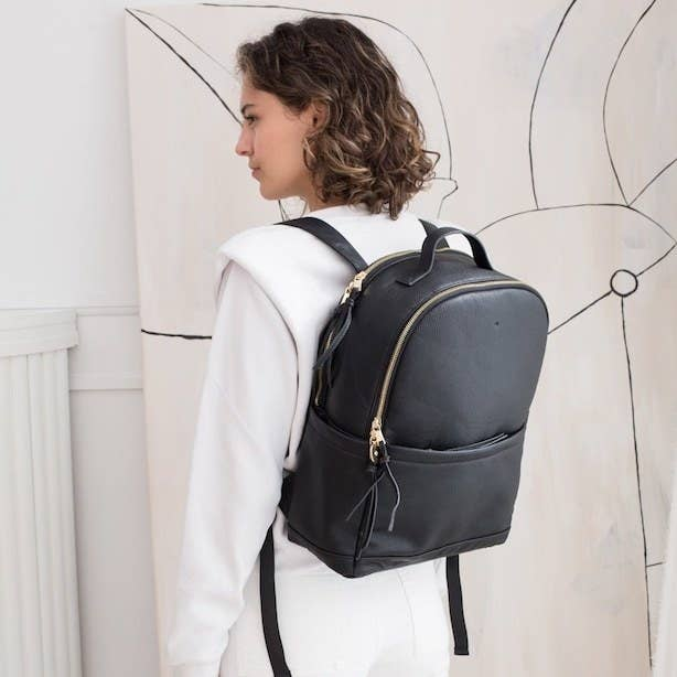 a person wearing a leather backpack