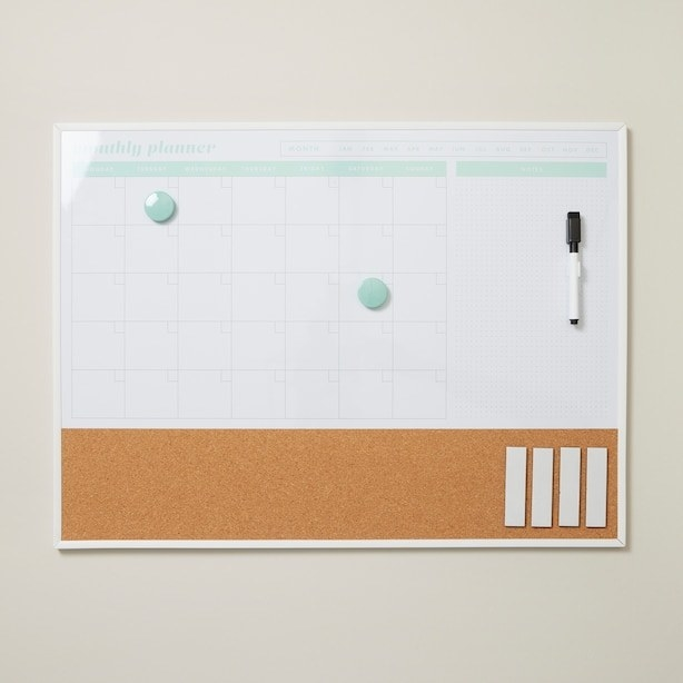 the monthly dry erase board with two magnets, cork board, and dry erase marker