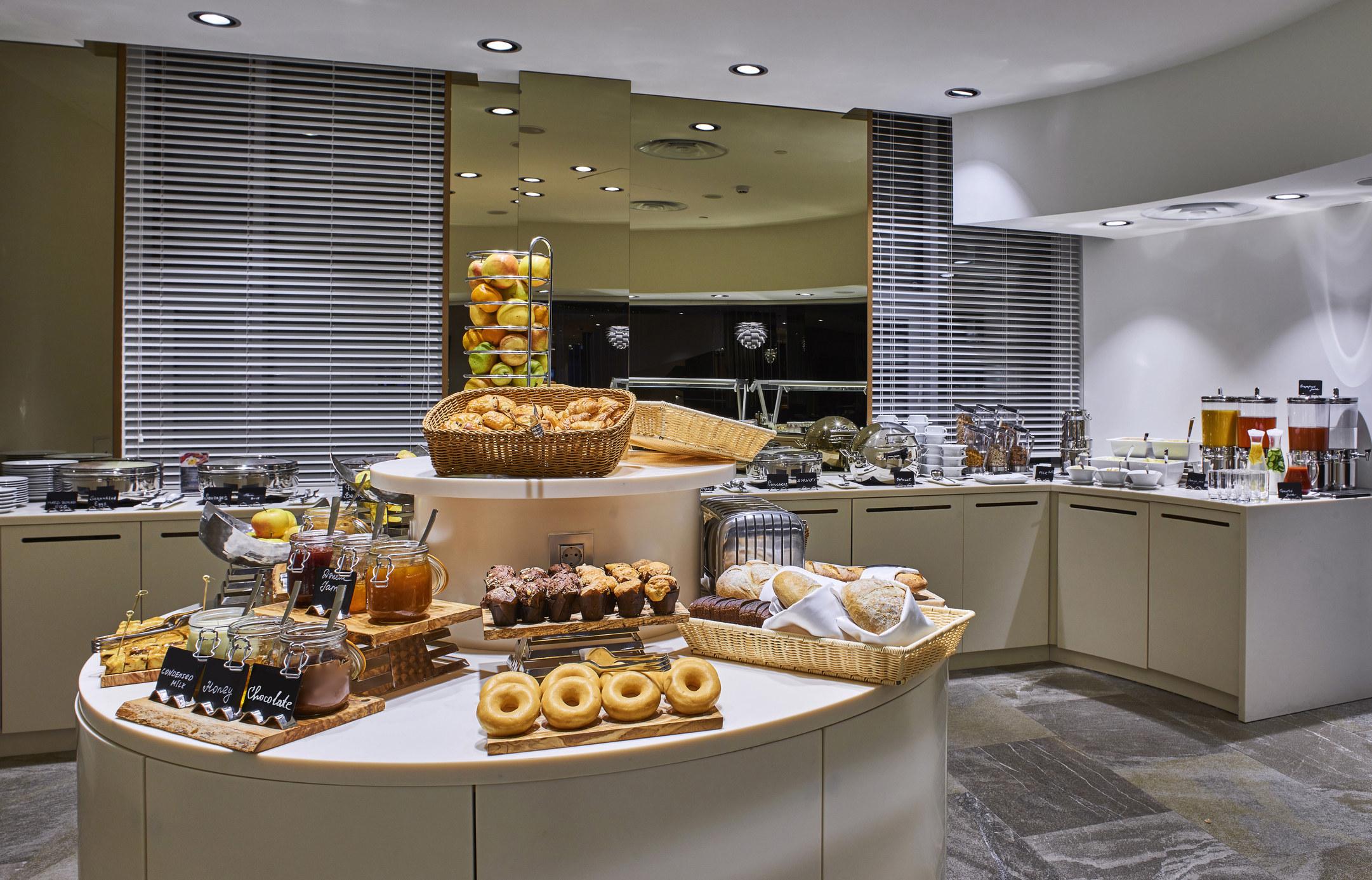 A continental breakfast bar at a hotel