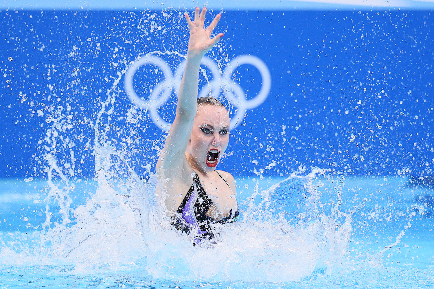 A woman swimmer performs in the pool at the Tokyo Olympics