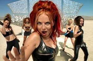 """geri in the """"say you'll be there"""" video, singing with mouth wide open, brows furrowed"""
