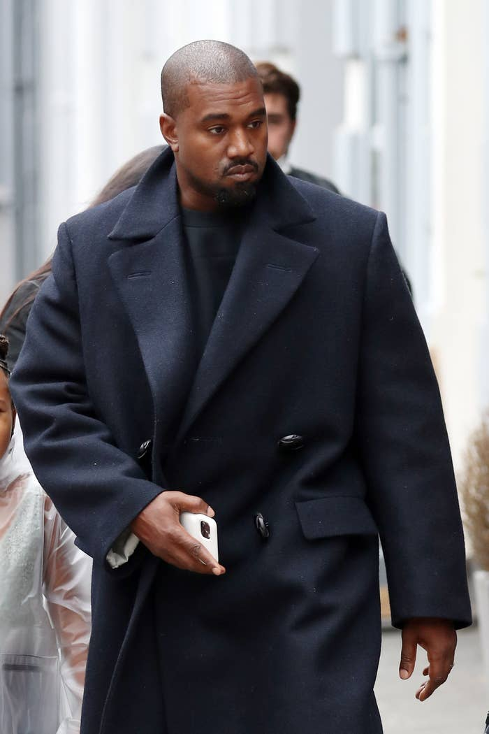 Kanye West is photographed walking outside in London in 2020
