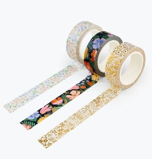 three rolls of decorative tape