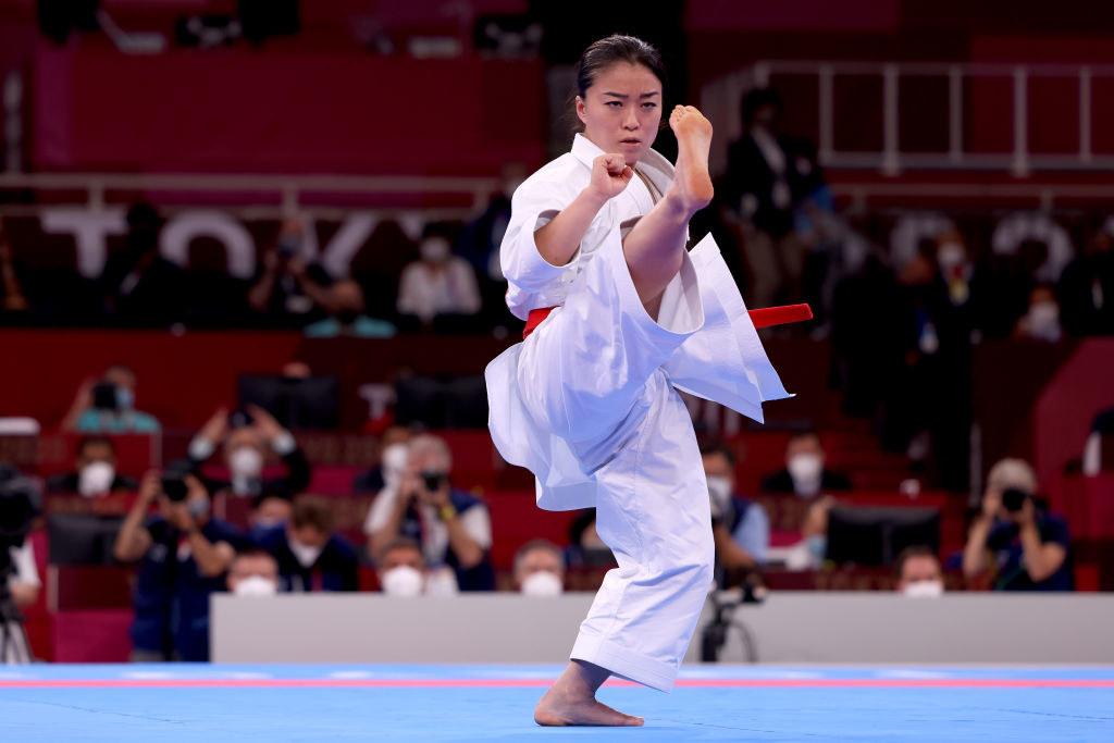 Kokumai kicks in the air during the Women's Karate Kata Elimination Round
