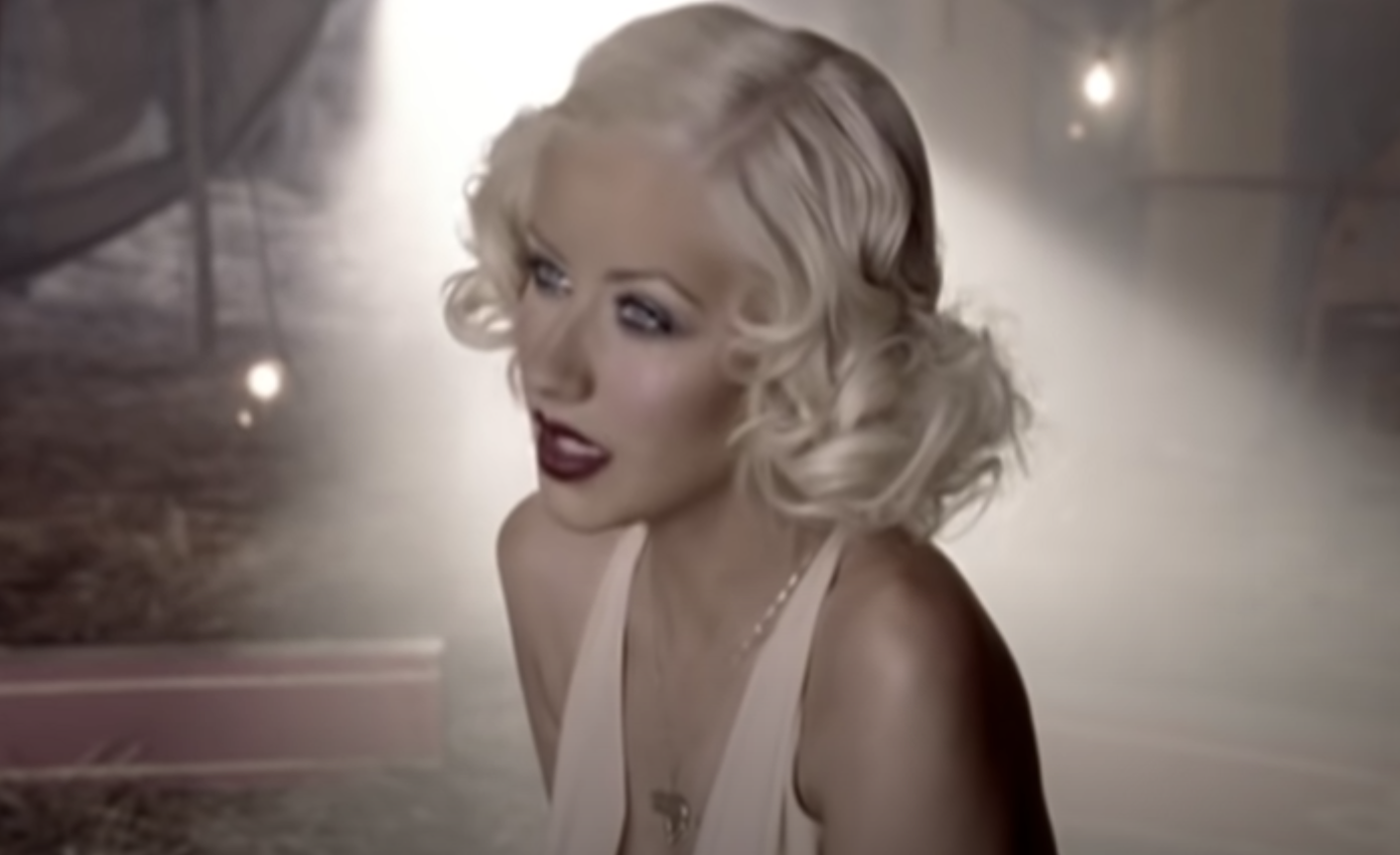 Christina singing dressed as Marilyn Monroe in the music video