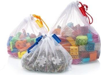 Three mesh bags containing toys