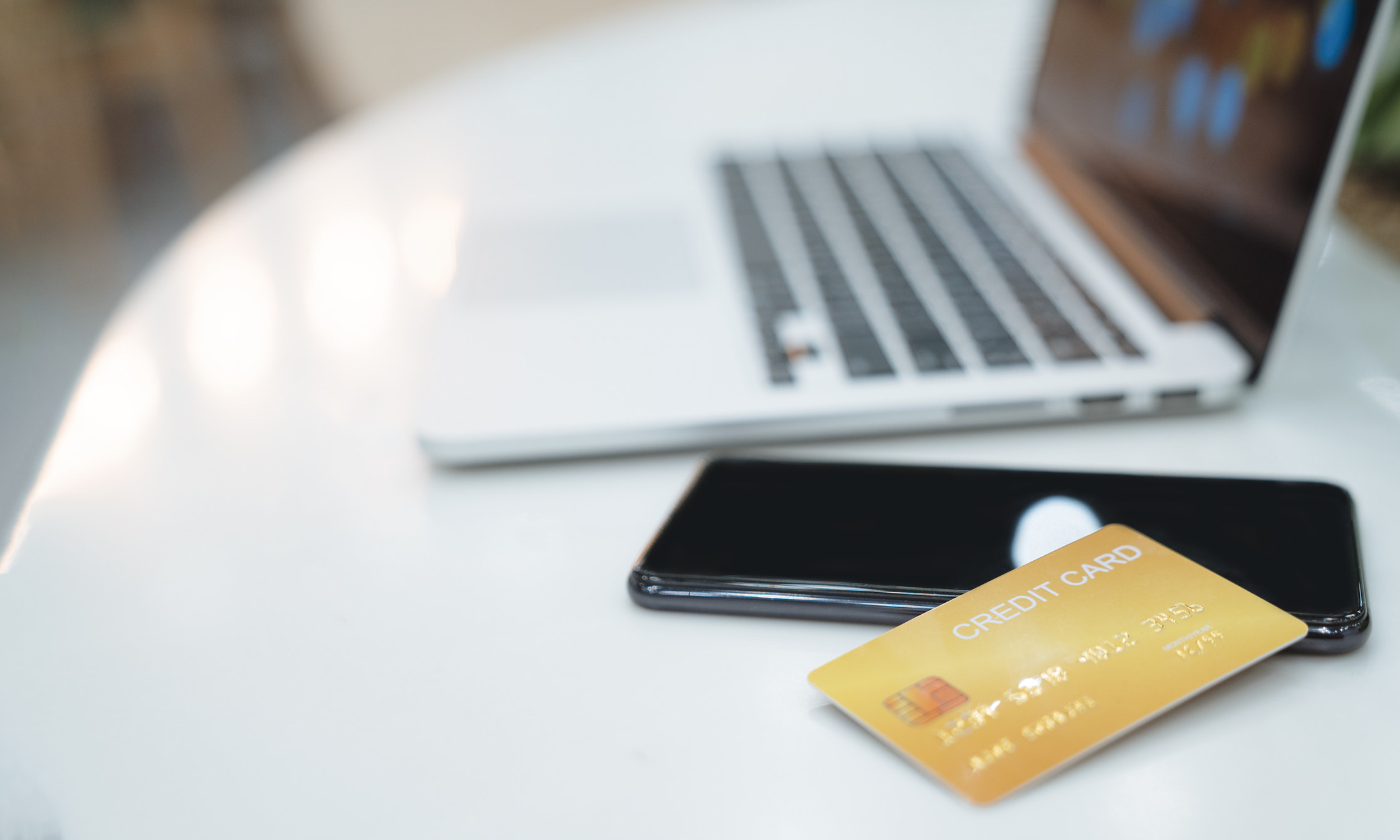 A credit card, cellphone, and hotel reservation pass