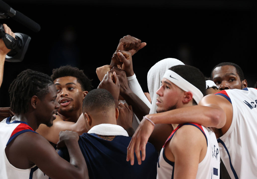 The team huddling together after winning the semifinal game against Australia