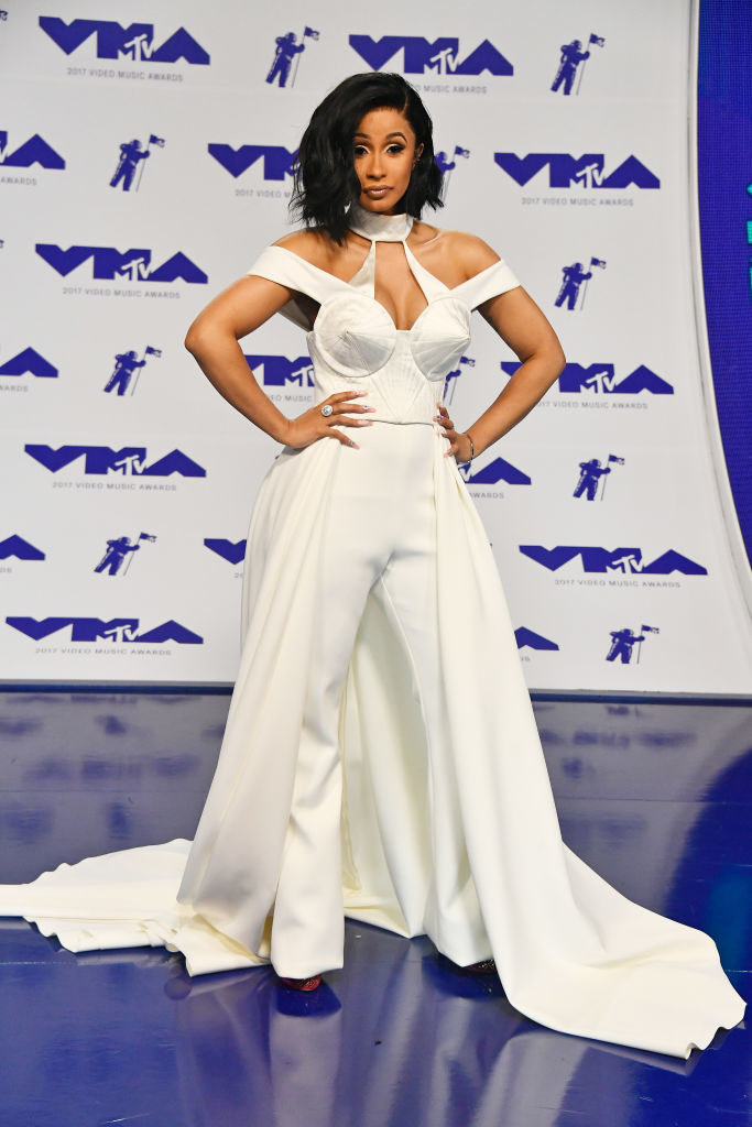 she wore a white pantsuit and cape to the 2017 VMAs