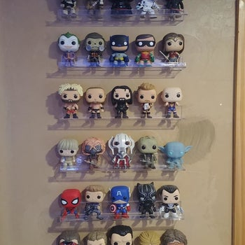 Reviewer's photo showing their funko pops displayed on the invisible floating shelves attached to the wall