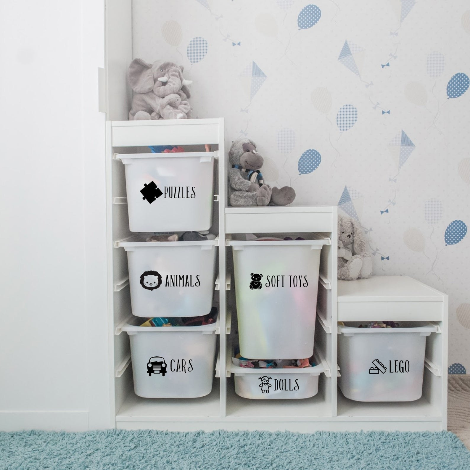The custom vinyl labels applied on the toy storage bins