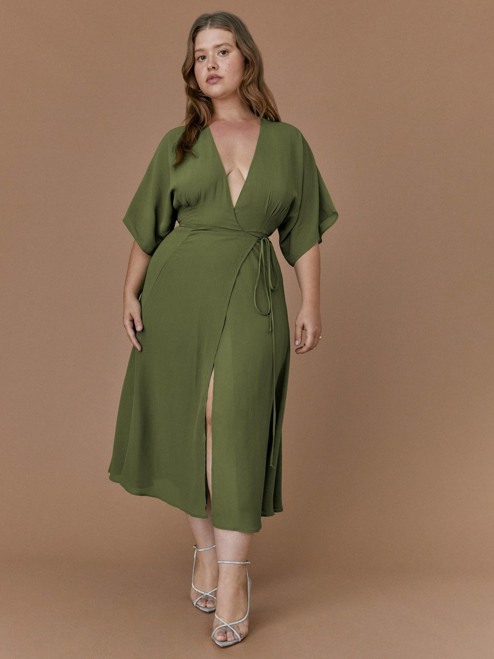 Model wearing green wrap dress