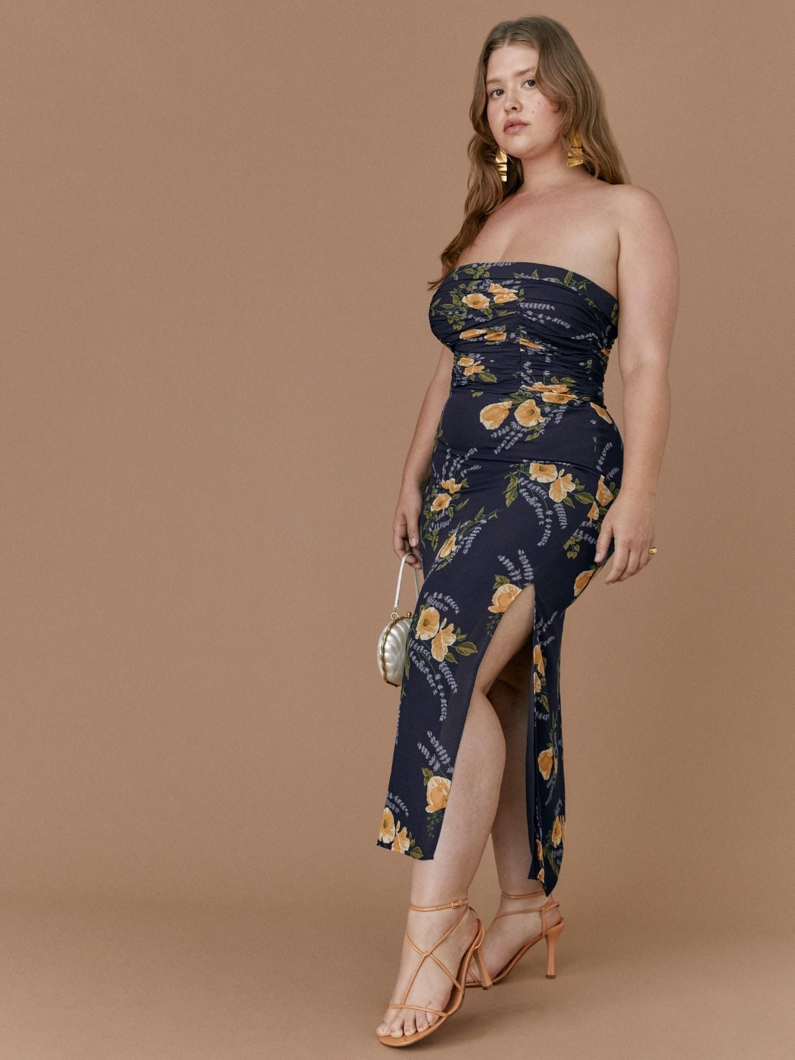 Model wearing blue tube top dress