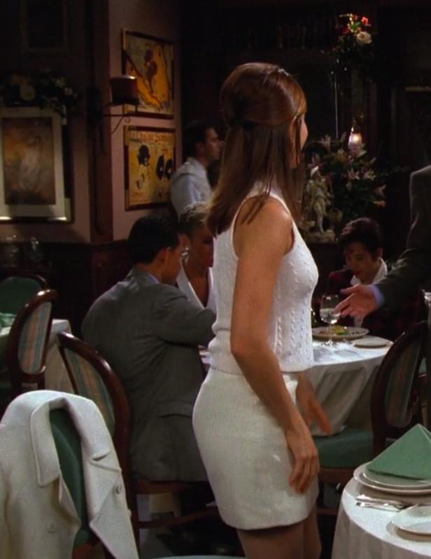 Rachel wearing a skirt, a knit top, and a matching coat