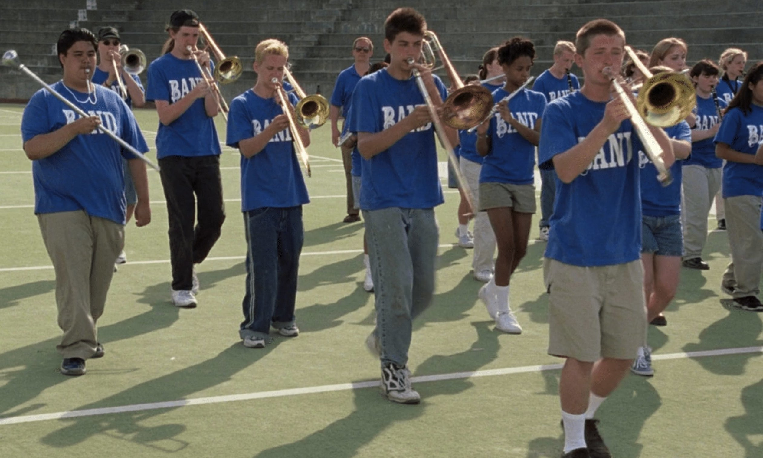 Marching band on football field performs
