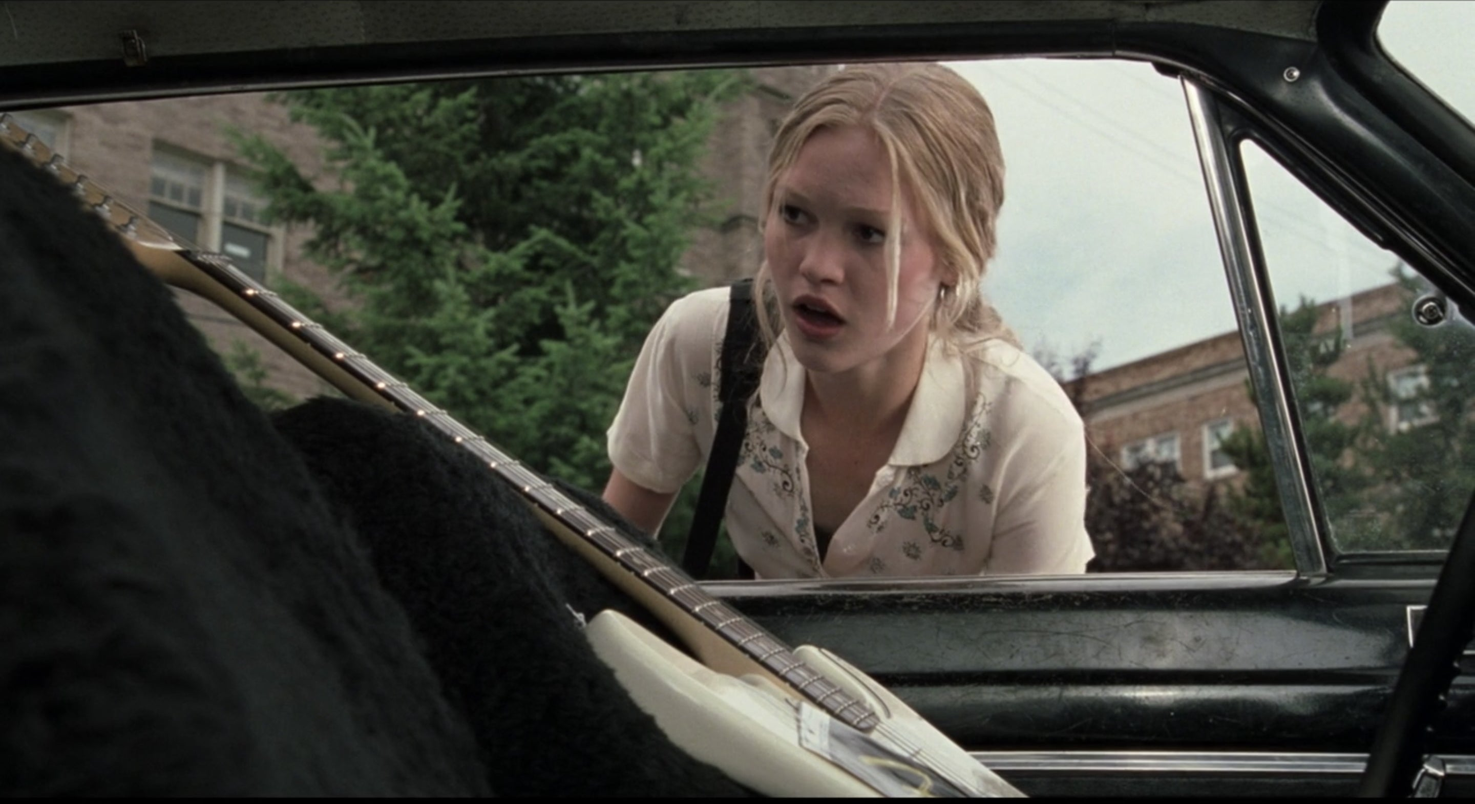 Kat is shocked to see a guitar sitting in her driver's seat