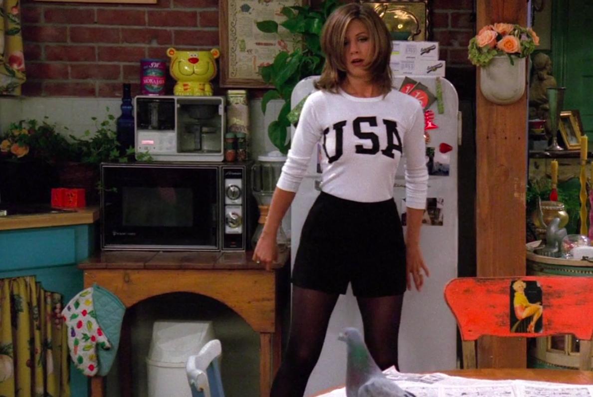 Rachel wearing booties, tights, shorts, and a USA long-sleeve shirt