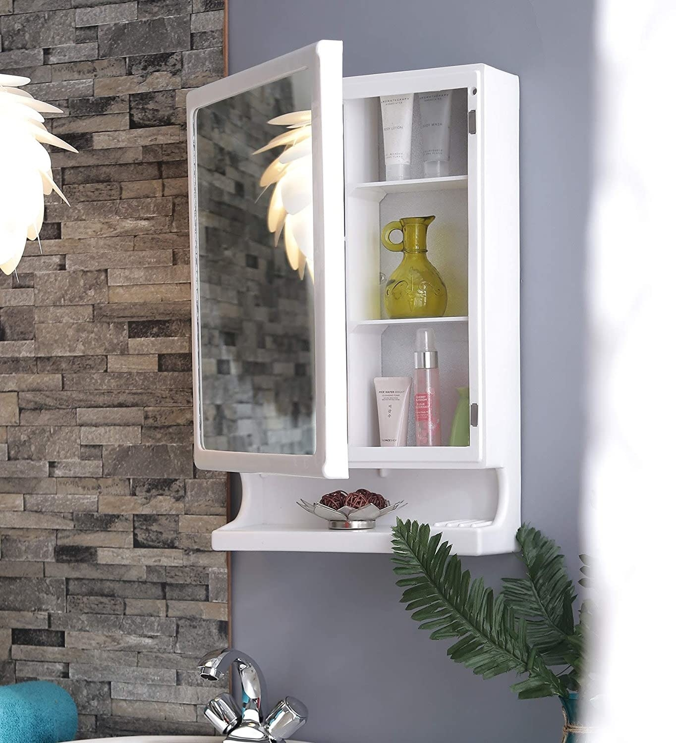 A white bathroom cabinet with a mirror and storage racks
