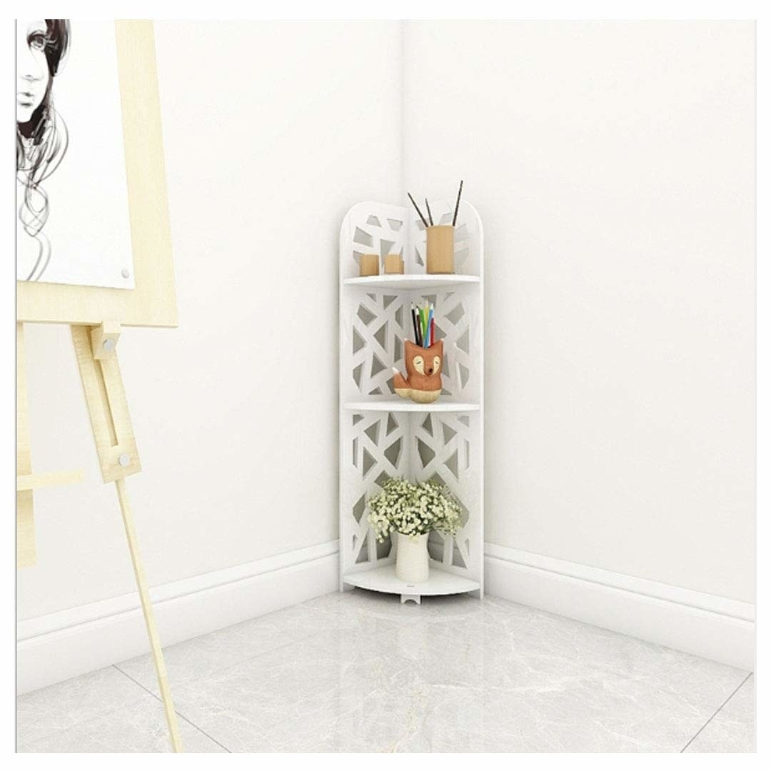 A white 3-tier corner rack with a geometric design and small trinkets kept on it