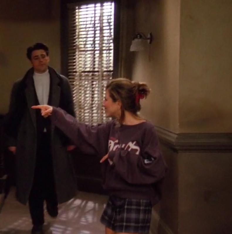 Rachel wearing socks, boxers, and a sweatshirt
